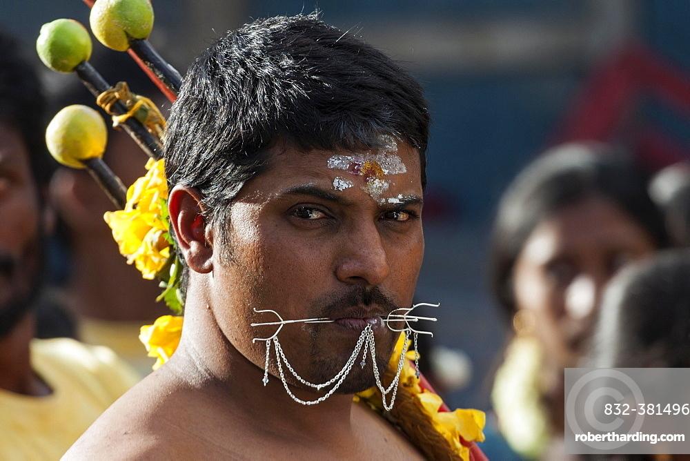 Local man at a Hindu festival, portrait, near Mahebourg, Mauritius, Africa
