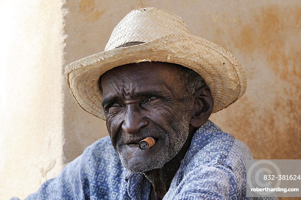 Man with cigar and straw hat, Trinidad, Sancti Spiritus Province, Cuba, Central America