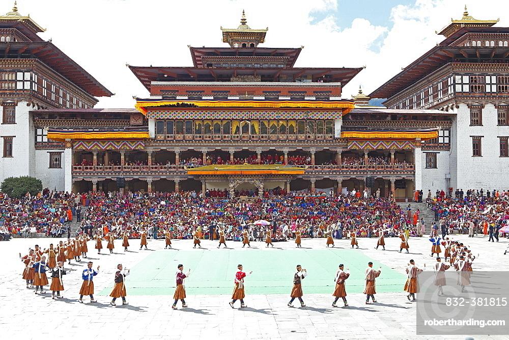 Dancers and spectators at the Tashichho Dzong monastery festival, Thimphu, Bhutan, Asia