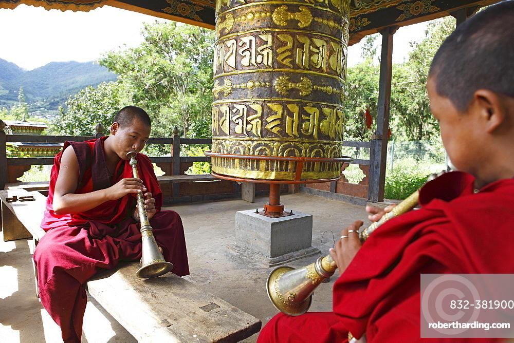 Monks playing Gyalings, Chimi Temple, Punakha District, Bhutan, Asia