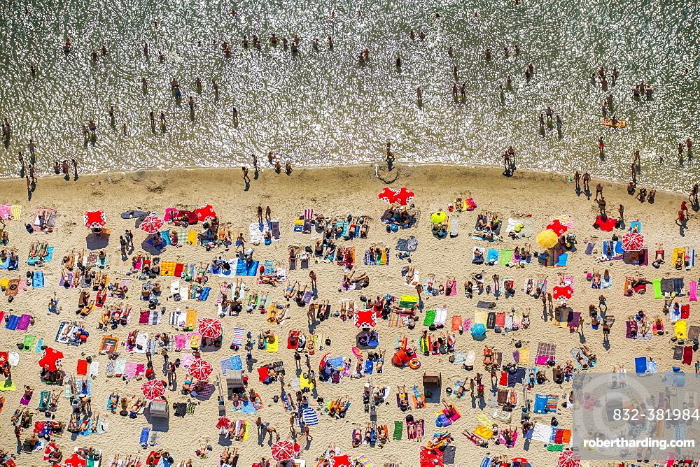 Sundown Beach, bathers on towels at Escher lake, lake in Cologne, Rhineland, North Rhine-Westphalia, Germany, Europe