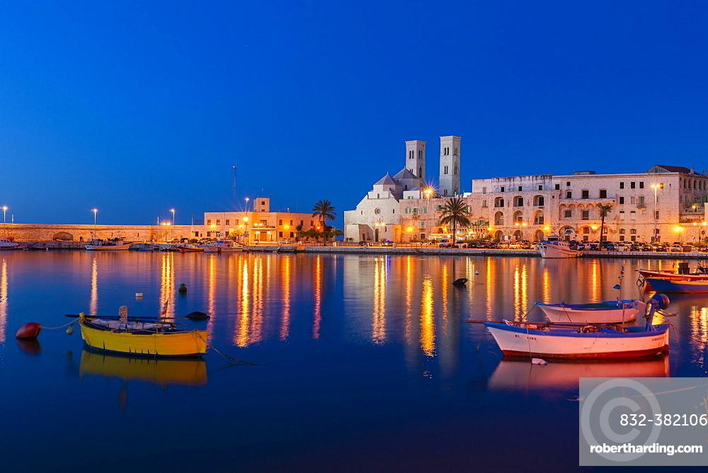 Blue Hour, dusk, fishing boats, harbour, historic centre, with the Romanesque Duomo Vecchio, old cathedral, San Corrado, Molfetta, Bari Province, Apulia, Italy, Europe