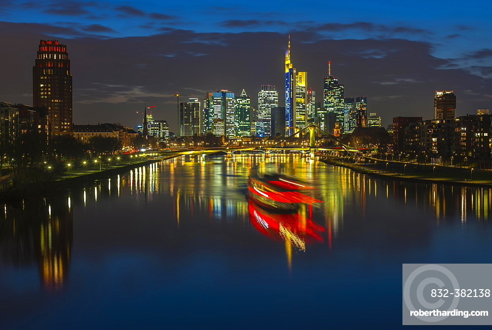 Trail of light from boat in front of skyline, blue hour, Osthafen, Frankfurt am Main, Hesse, Germany, Europe