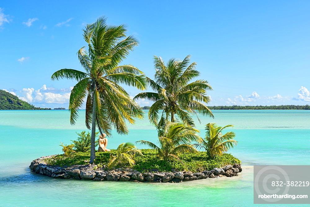 Palm trees on a small South Seas island, Bora Bora, French Polynesia, Oceania