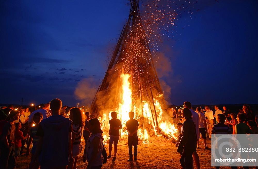 People standing around a Sonnwendfeuer bonfire, Johannifeuer, Upper Bavaria, Bavaria, Germany, Europe