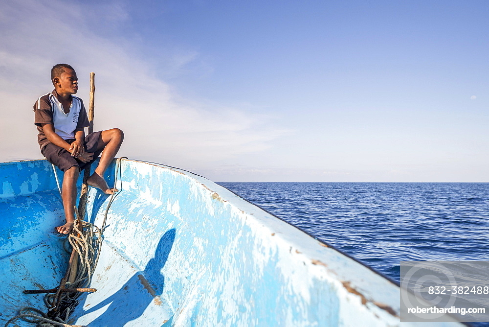 Boy on a fishing boat looking out to the sea, Yasawa Islands, Fischi