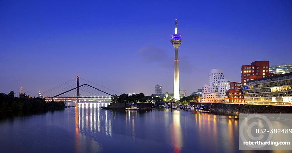 Rhine tower, Gehry Buildings, Neuer Zollhof, media harbor, dusk, blue hour, Dusseldorf, North Rhine-Westphalia, Germany, Europe