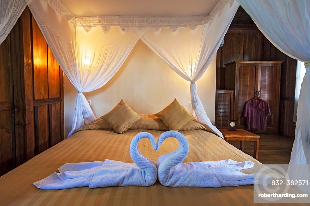 Bed in Palm Bungalow, Wakatobi Dive Resort, Sulawesi, Indonesia, Asia
