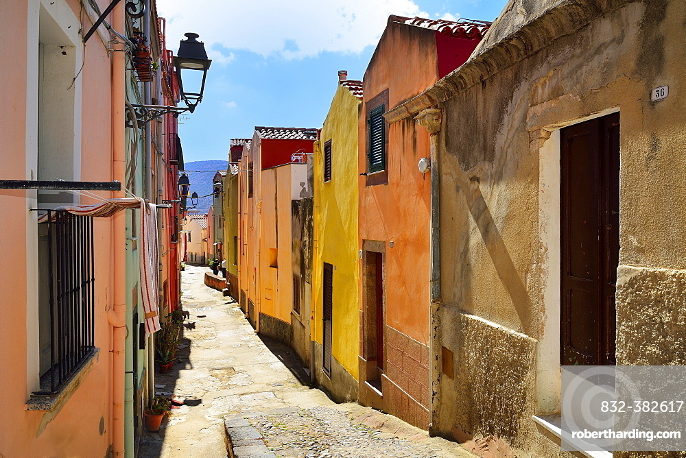 Colourful houses in a narrow alleyway of the historic centre, Bosa, Oristano Province, Sardinia, Italy, Europe