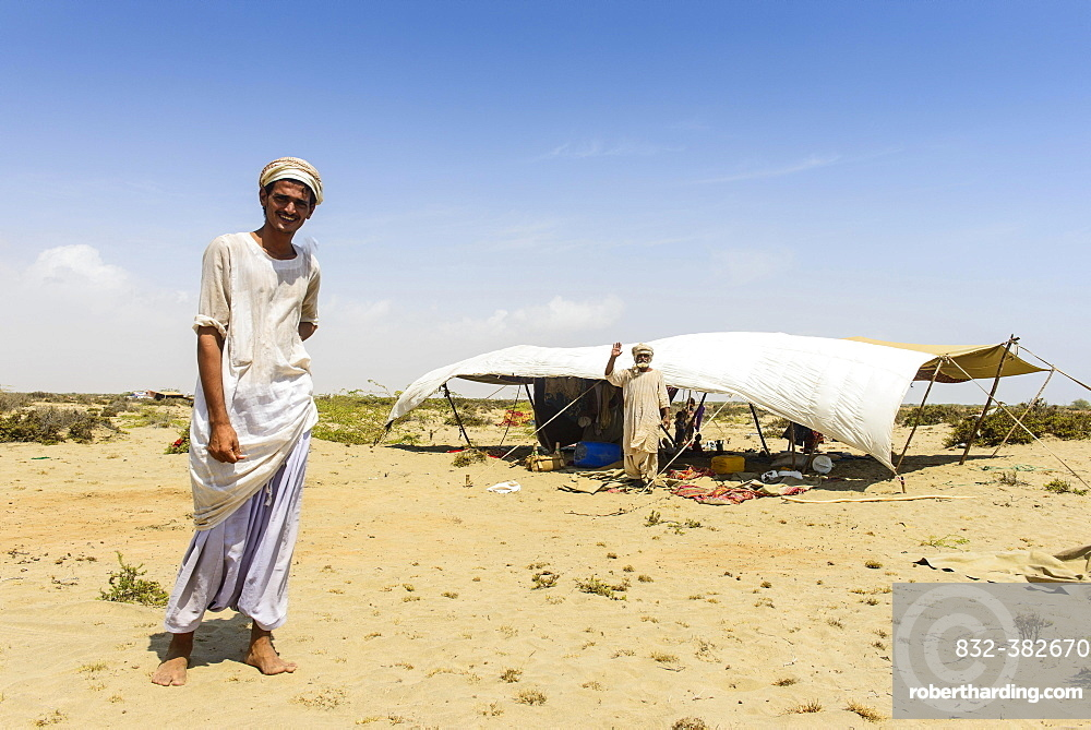 Rashaida man standing in front of his tent in the desert around Massaua, Eritrea, Africa