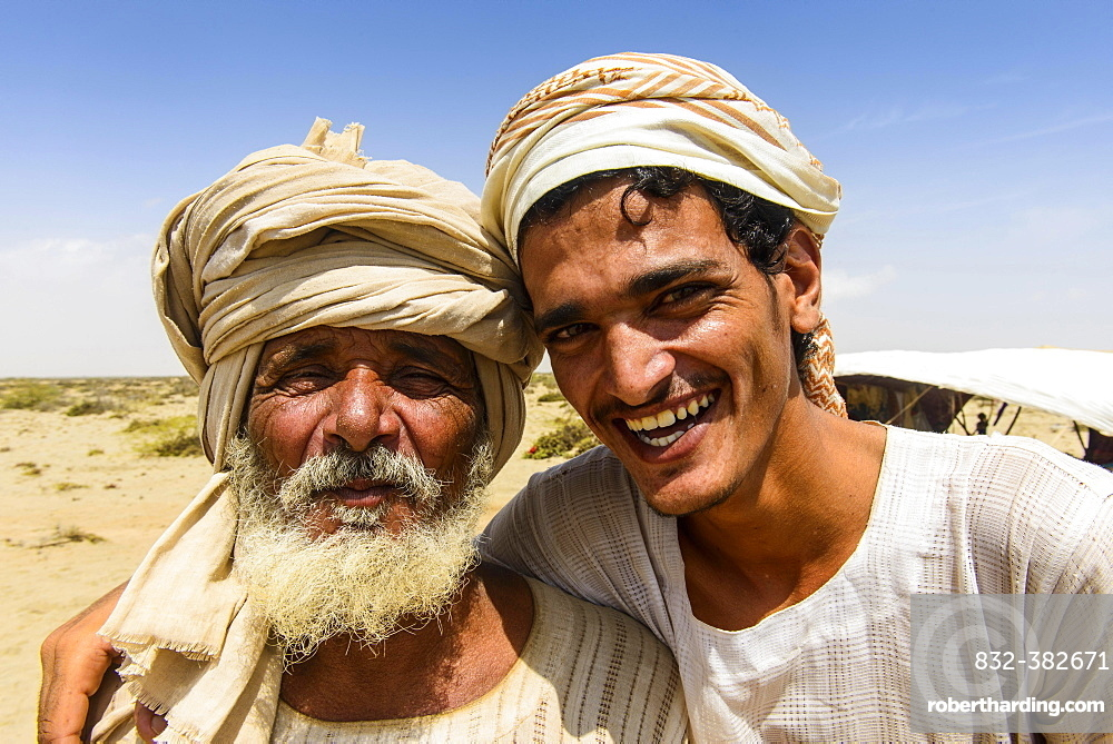 Rashaida father and son standing in front of their tent in the desert around Massaua, Eritrea, Africa