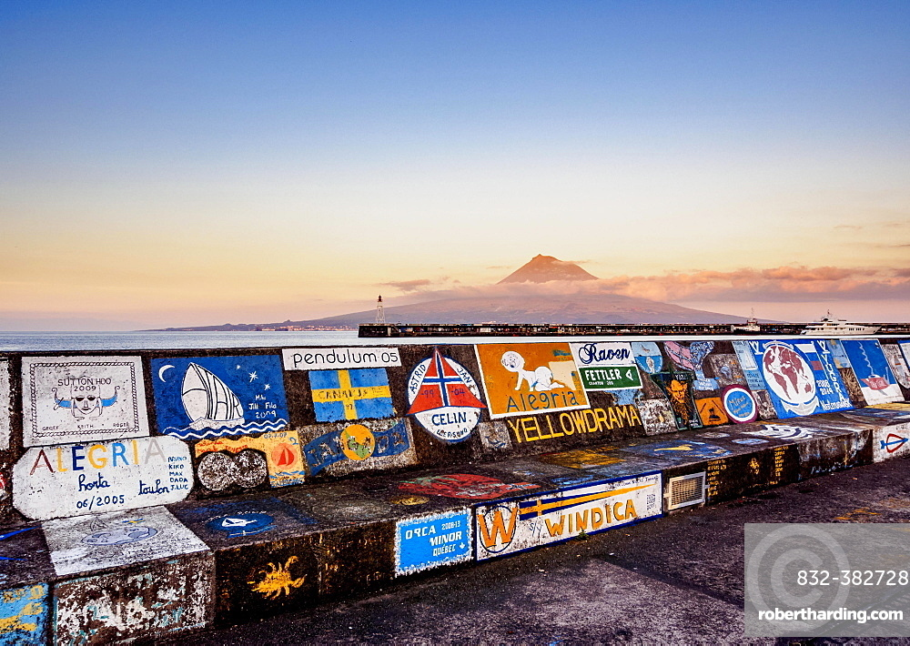 Painted quay wall at the yacht harbour with view of Pico Volcano at dusk, Horta, Faial, Azores, Portugal, Europe