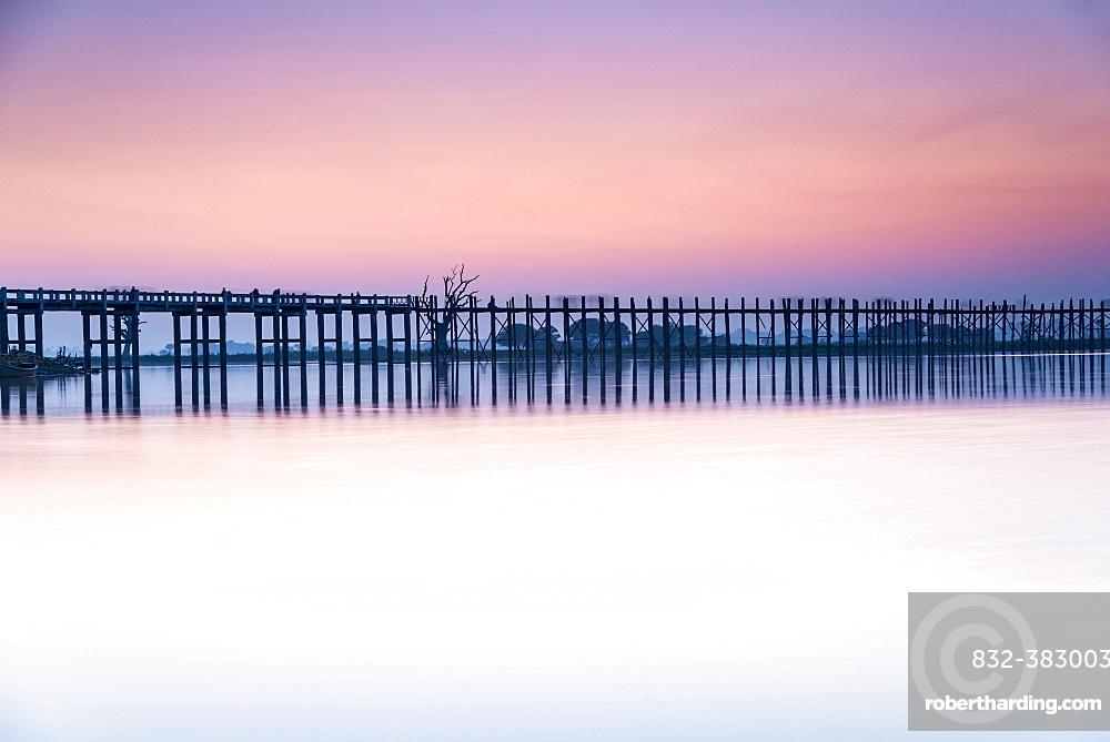 Teak bridge in the evening light, U Bein bridge across Thaungthaman Lake, Amarapura, Mandalay Division, Myanmar, Asia