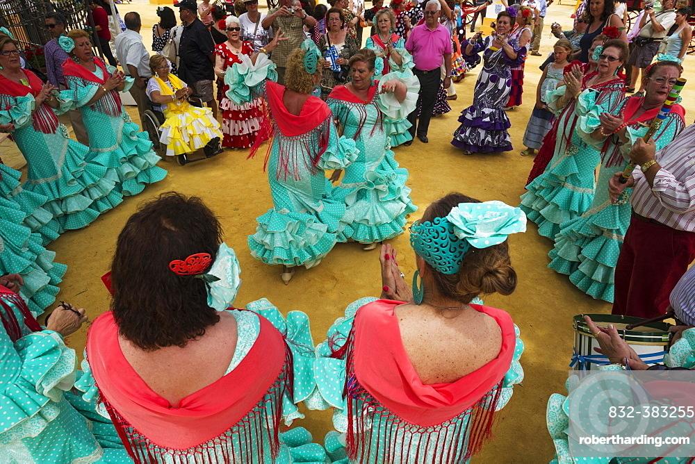 Women wearing gypsy dresses perform traditional Andalusian dances at the Feria del Caballo, Jerez de la Frontera, Cadiz province, Andalusia, Spain, Europe