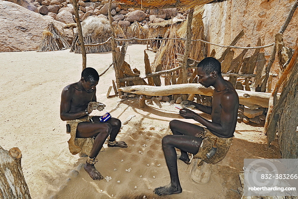 Two local men rolling cigarettes, Damara Living Museum, near Twyfelfontein, Namibia, Africa
