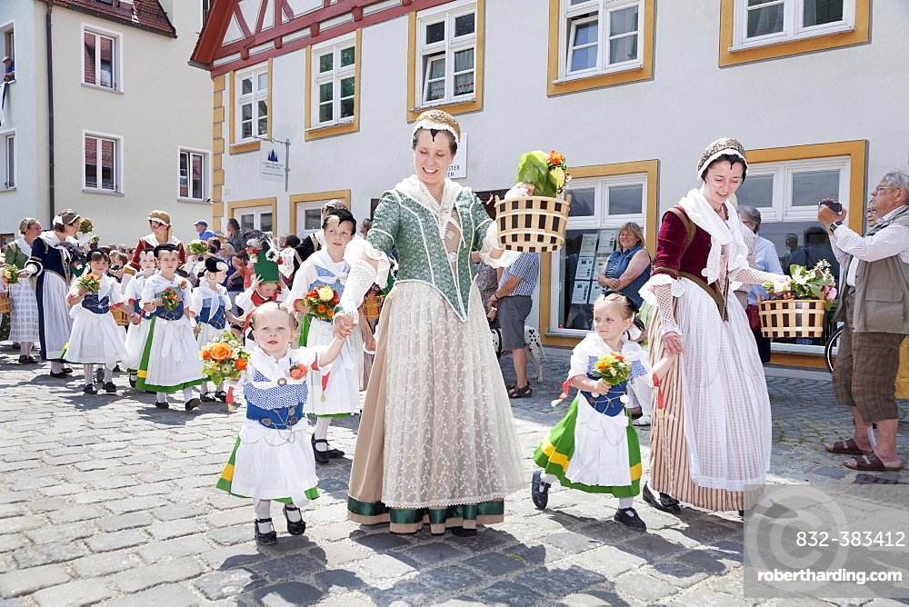 Women and children during a parade through the historic town centre, Fischerstechen or water jousting festival, Ulm, Baden-Wurttemberg, Germany, Europe