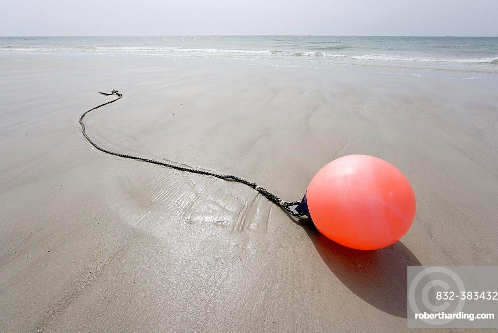 Buoy lying on the beach, Schleswig-Holstein, Germany, Europe