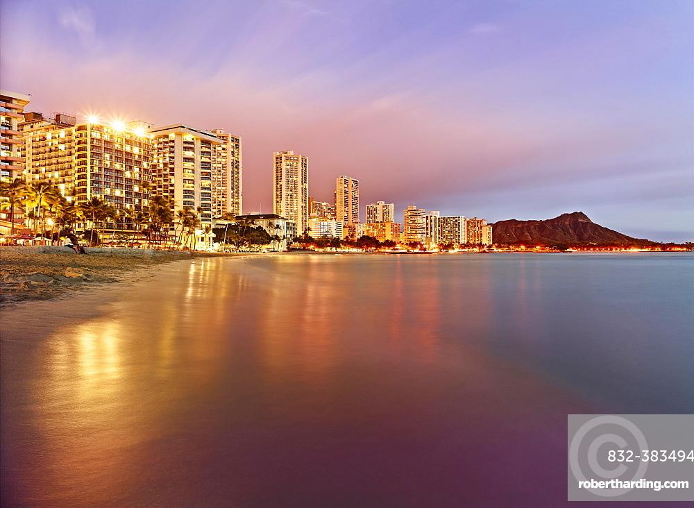 Waikiki Beach at dusk, Honolulu, Oahu, Hawaii, United States, North America