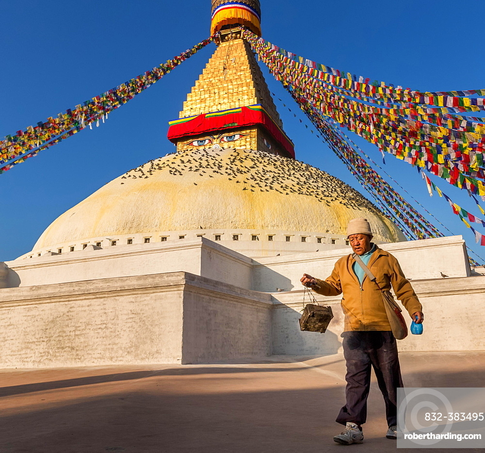 A man walking around Boudhanath stupa, Boudhanath, Kathmandu, Kathmandu District, Bagmati Zone, Nepal, Asia