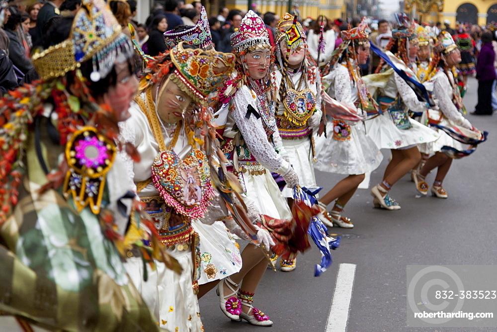 Dancing masks at the Fiesta del Carmen, Lima, Peru, South America
