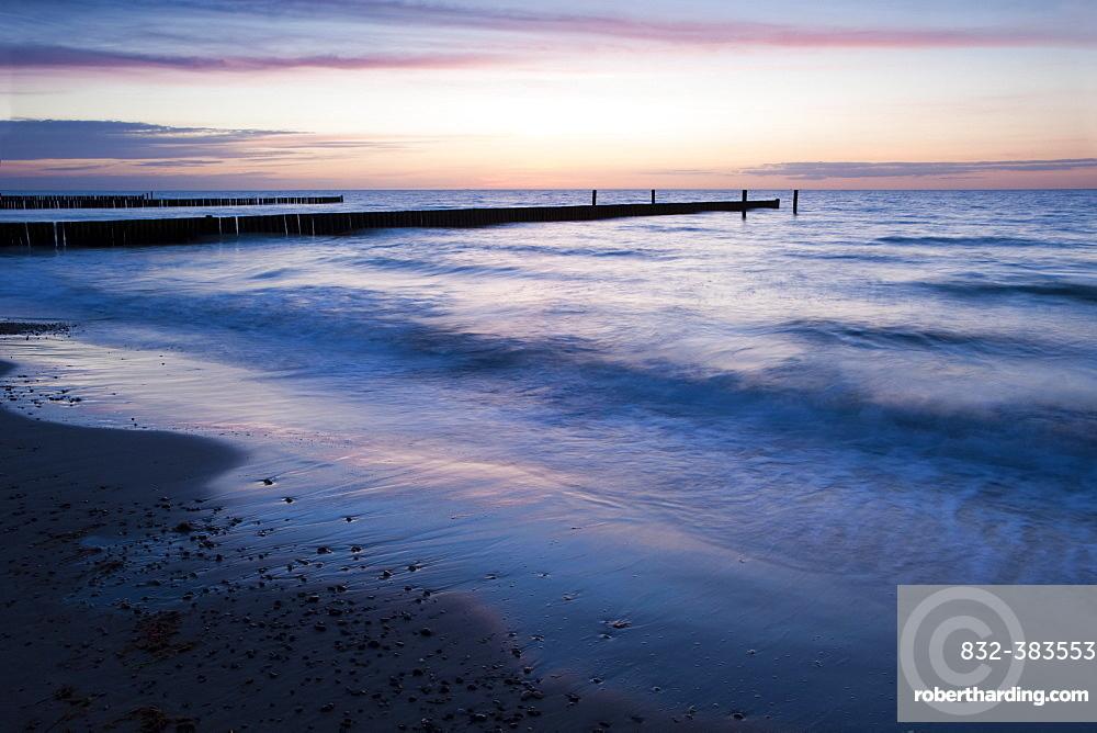 Groyne at sunset on the coast at, Nienhagen, Mecklenburg-Western Pomerania, Germany, Europe