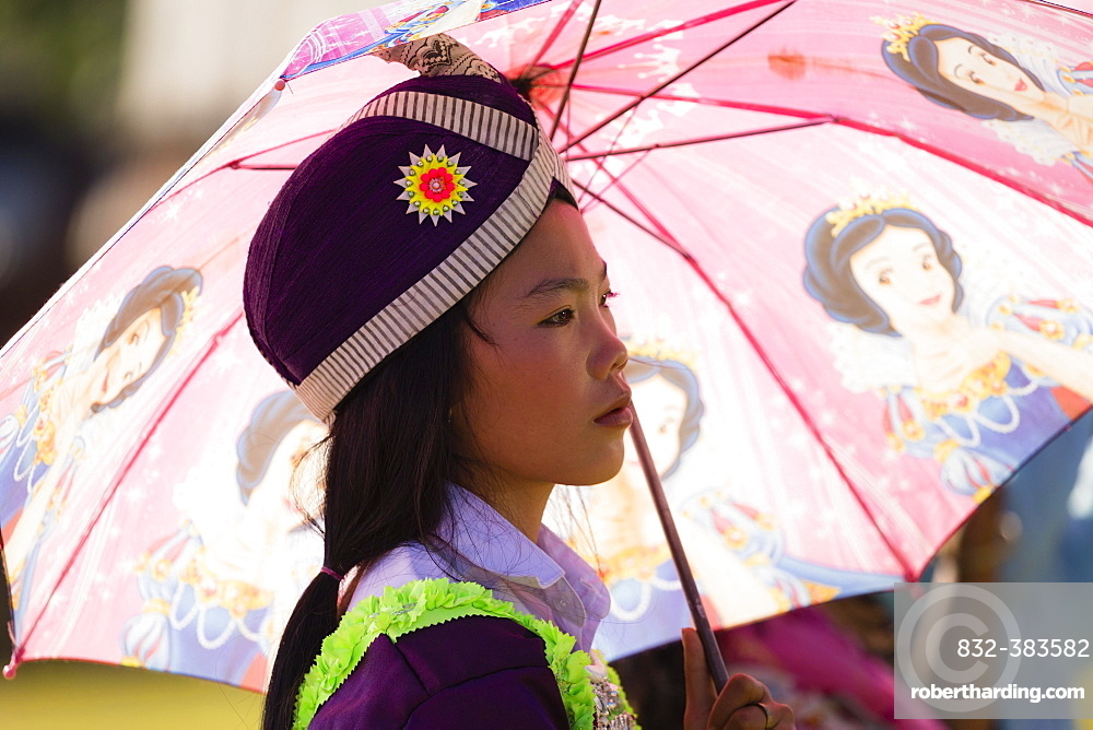 Young woman dressed in a traditional Hmong costume, Hmong New Year's Celebration, Phonsavan, Xiangkhouang, Laos, Asia