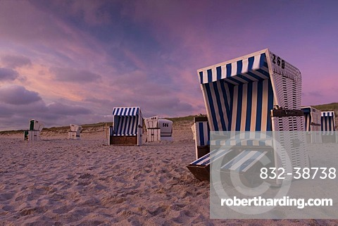 Roofed wicker beach chairs on the beach just after sunset, Hoernum, Sylt island, North Friesland district, Schleswig-Holstein, Germany, Europe