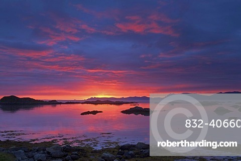 A spectacular sunrise above the Norwegian Sea seen from Langenes near Sto, Sto, at the tip of the island of Langoya, Langoya, part of the archipelago of VesterÂlen, Vesteralen, Nordland, Norway, Europe