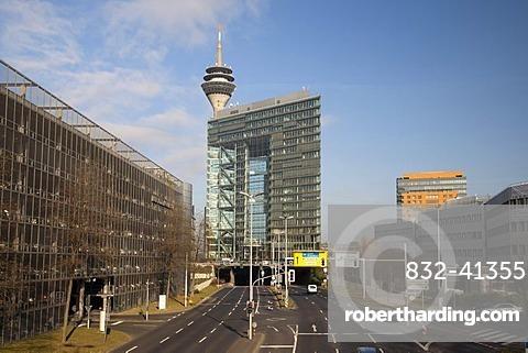 Voelklinger Strasse road with Stadttor building and Rheinturm tower, Medienhafen, Duesseldorf, state capital, Rhineland, North Rhine-Westphalia, Germany, Europe