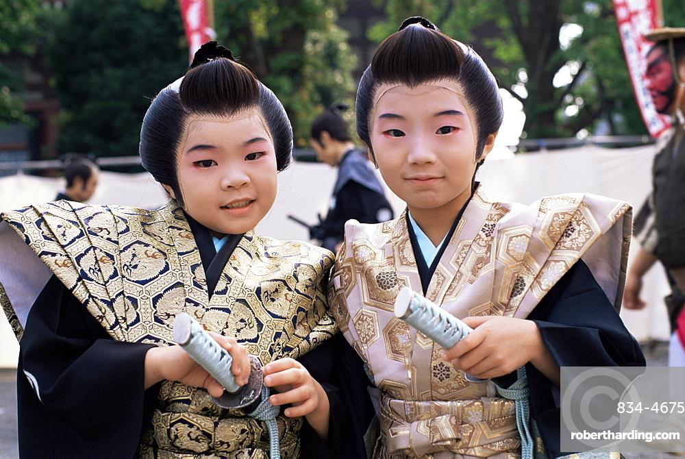 Two boys dressed in Samurai costume at Jidai Matsuri Festival held annually in November at Sensoji Temple Asakusa, Tokyo, Honshu, Japan, Asia