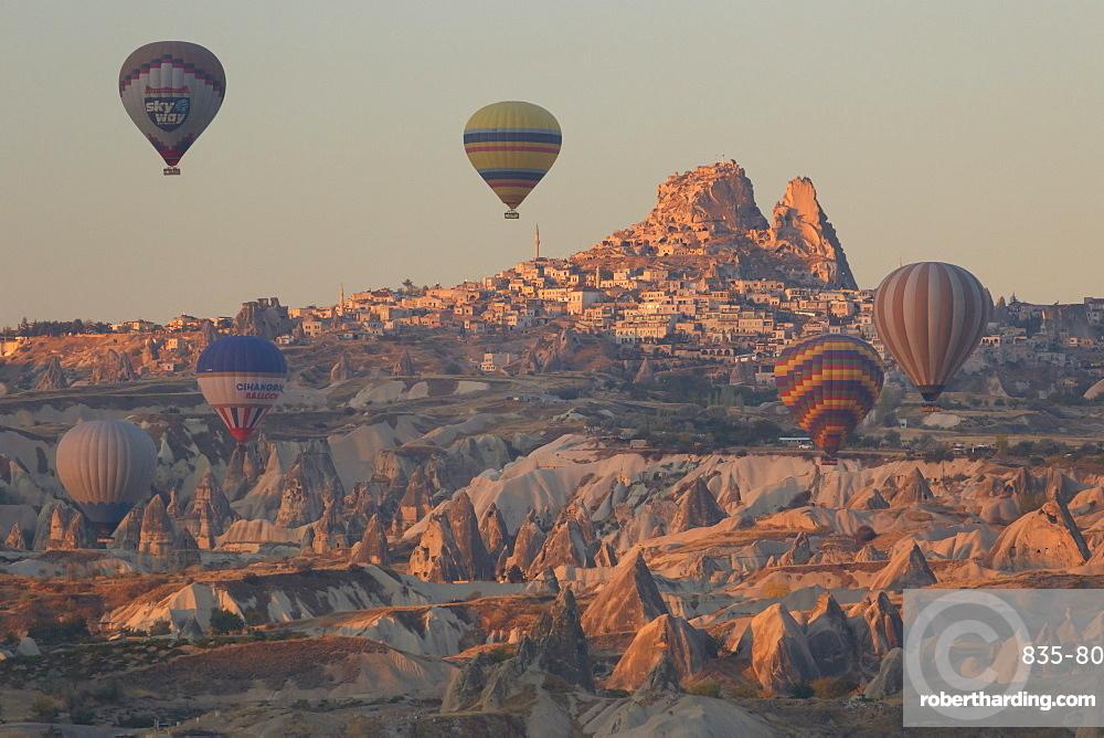 Hot air balloons rising into the dawn sky above Goreme, Cappadocia, Anatolia, Turkey, Asia Minor, Eurasia