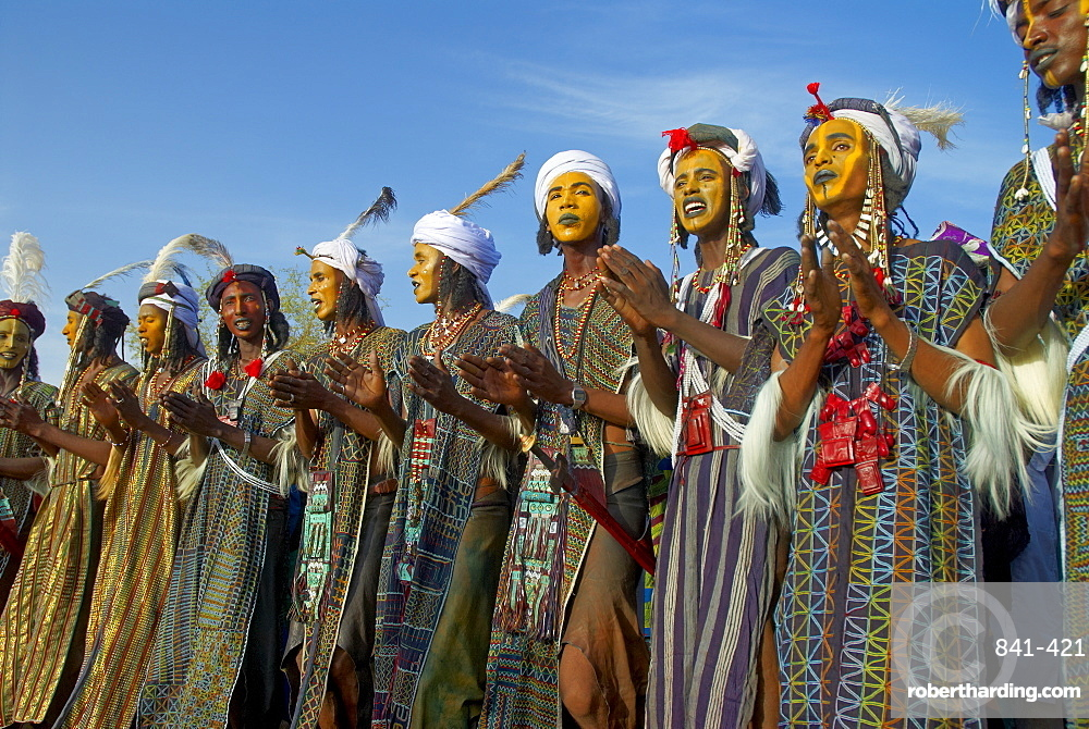 Group of Wodaabe (Bororo) men with faces painted for the annual Gerewol male beauty contest, the general reunion of West Africa for the Wodaabe Peul (Bororo Peul) people, Niger, West Africa, Africa