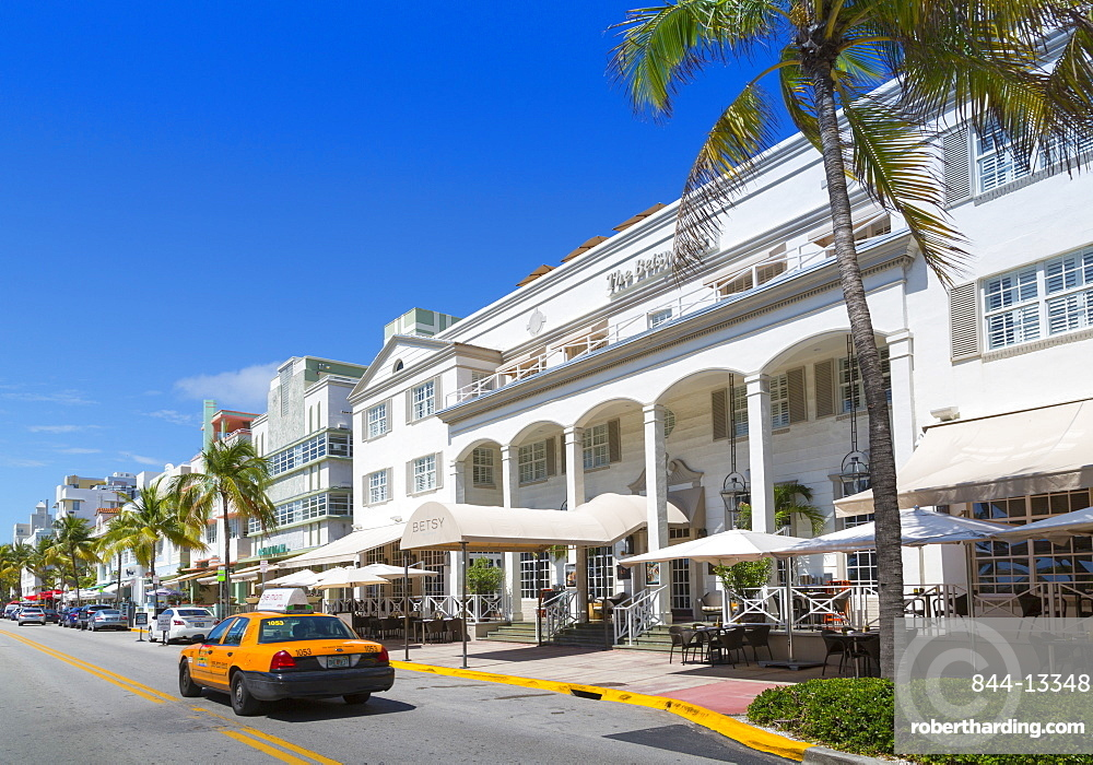 Ocean Drive and Art Deco architecture and yellow cab, Miami Beach, Miami, Florida, United States of America, North America