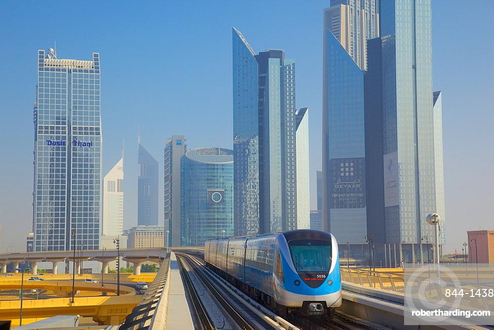Metro and skyscrapers on skyline, Dubai, United Arab Emirates, Middle East