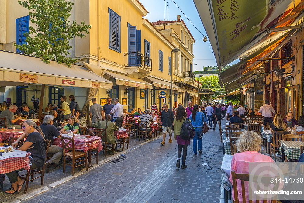 View of restaurants and cafes on Mitropleos during late afternoon, Athens, Greece, Europe
