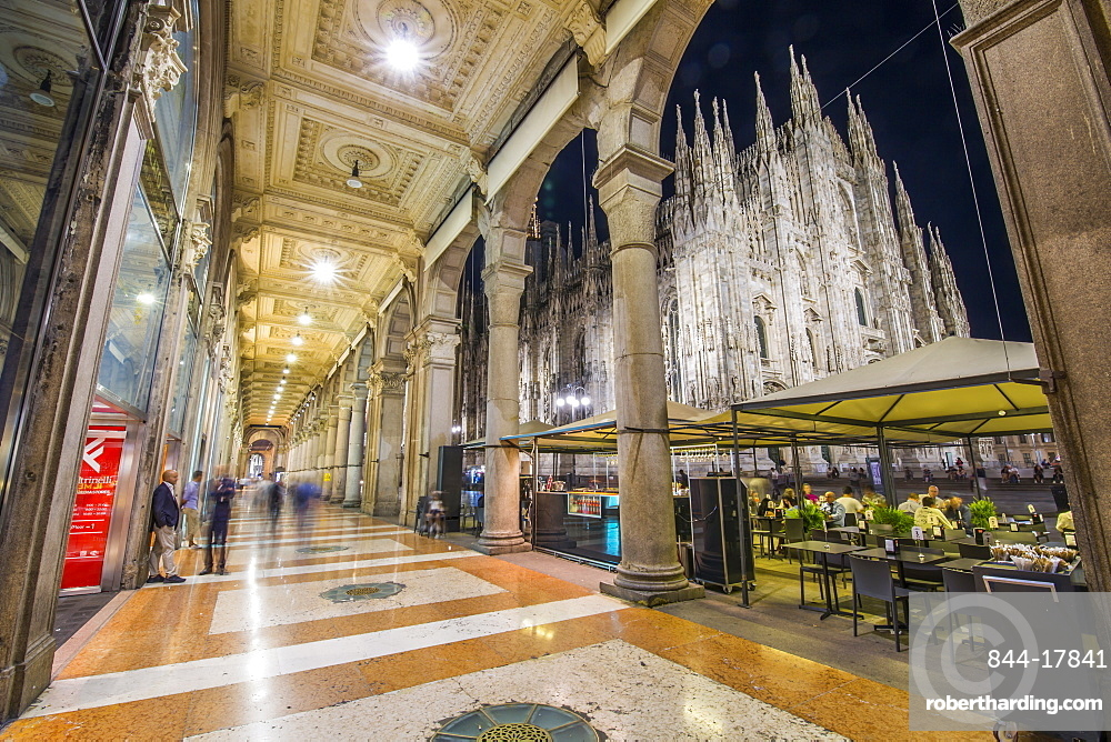 View of Duomo di Milano illuminated at dusk from Galleria Vittorio Emanuele II in Piazza Del Duomo at dusk, Milan, Lombardy, Italy, Europe