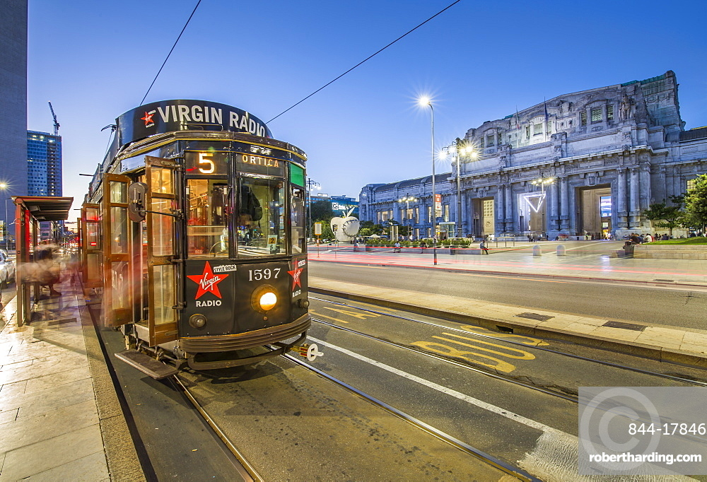City tram outside Milan Central Station at dusk, Milan, Lombardy, Italy, Europe