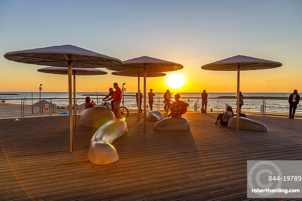 View of sunshades on promenade at sunset, Hayarkon Street, Tel Aviv, Israel, Middle East