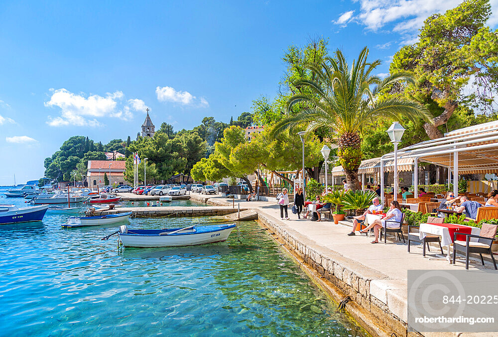 View of boats and old town restaurants in Cavtat on the Adriatic Sea, Cavtat, Dubronick Riviera, Croatia, Europe