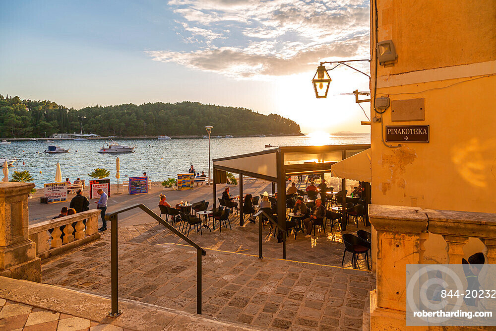 View of restaurant at sunset in Cavtat on the Adriatic Sea, Cavtat, Dubronick Riviera, Croatia, Europe