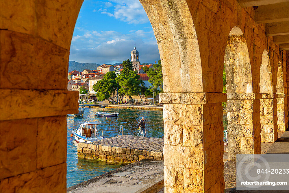 View of town and harbour through arches in Cavtat on the Adriatic Sea, Cavtat, Dubronick Riviera, Croatia, Europe