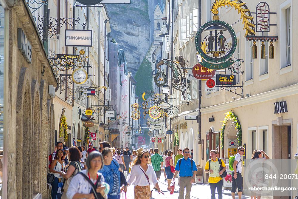 View of shoppers and signs on Getreidegasse, Salzburg, Austria, Europe