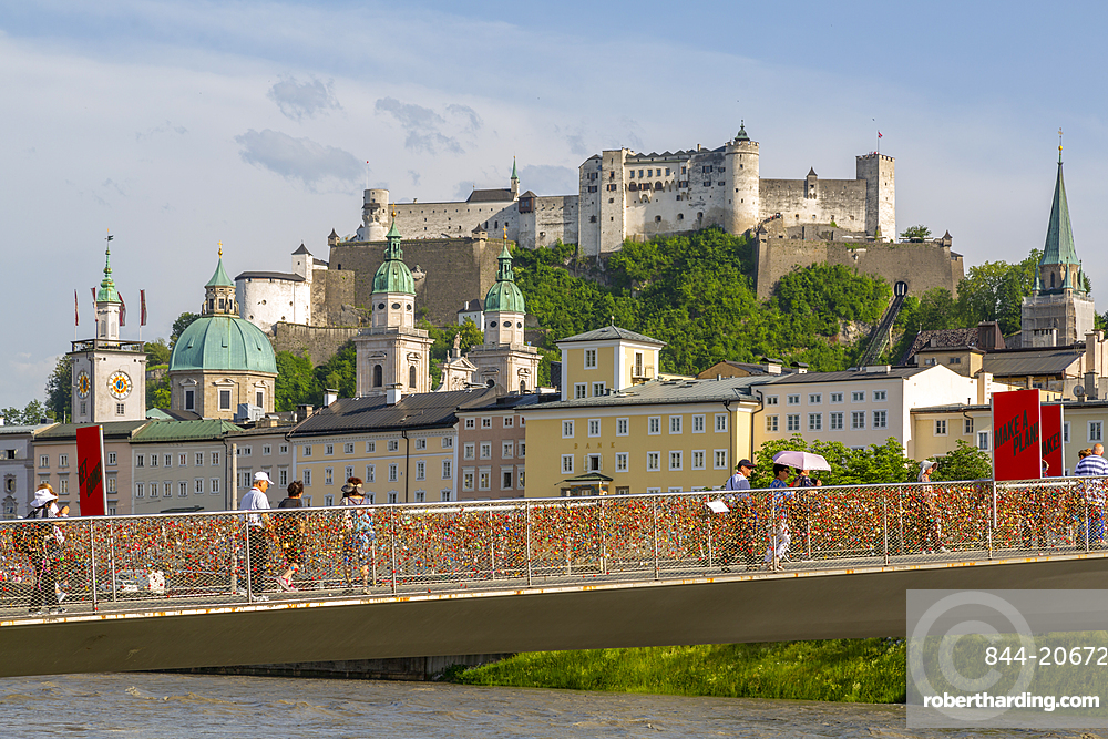 View of Hohensalzburg Castle and footbridge over Salzach River, UNESCO World Heritage Site, Salzburg, Austria, Europe