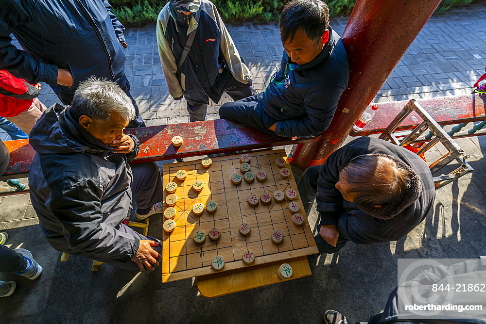 Locals playing board game in Gathering at the Ghost Corridor in the Temple of Heaven, Beijing, People's Republic of China, Asia
