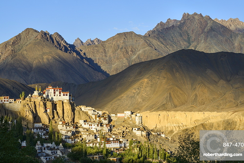 The town and monastery of Lamayuru, backed by mountains in the evening sun, Ladakh, Himalayas, India, Asia