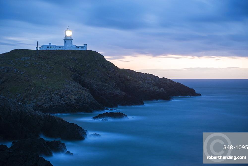 Strumble Head Lighthouse at dusk, Pembrokeshire Coast National Park, Wales, United Kingdom, Europe