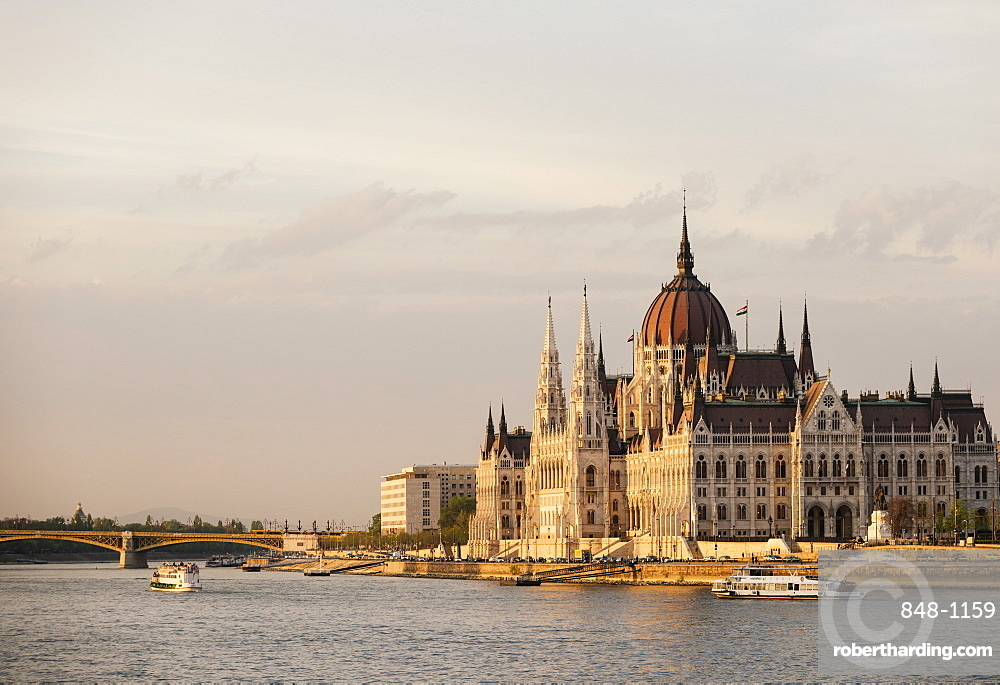 Evening light on the Hungarian Parliament Building and Danube River, Budapest, Hungary, Europe