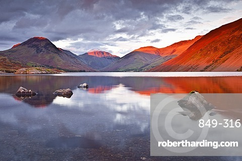 The Scafell range across the reflective waters of Wast Water in the Lake District National Park, Cumbria, England, United Kingdom, Europe