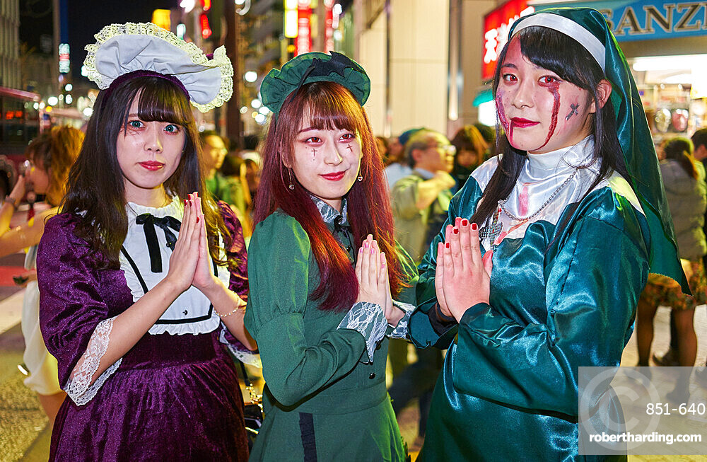 Young Japanese girls dressed as nuns at the Halloween celebrations in Shibuya, Tokyo