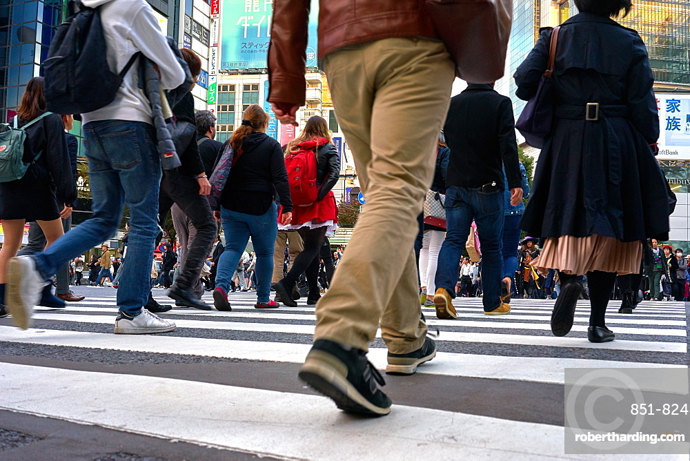 Low angle view of crowds walking through the Shibuya Crossing, Tokyo, Japan, Asia